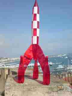 What's delaying liftoff? This rocket is constructed of recycled packaging material by artist Philippe Vergnory of France. Yes, in case you were wondering, that is Cannes harbor in the background.