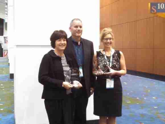 Excellence in Reusable Packaging Award winners. Left to right, Svenska Retursystem's xxx, Robert Engle, RPA Presdient, and Samantha Goetz of ORBIS Corporation,
