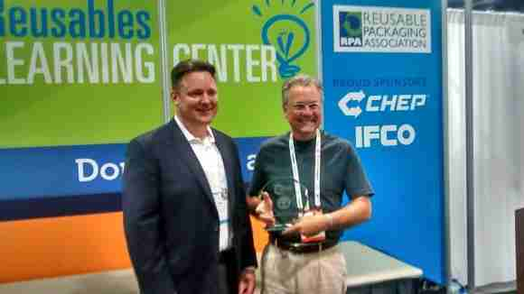 RPA's Tim Debus awards Dave Martin with the Excellence in Reusable Packaging Award during PACK EXPO 2015.