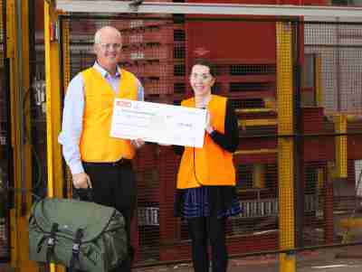 Presentation to Ms Lisa Clarke, Operations Manager and Co-designer of Backpack Bed of Swags for Homeless, by Mr Daniel Bunnett, Executive Vice President for Australia and New Zealand