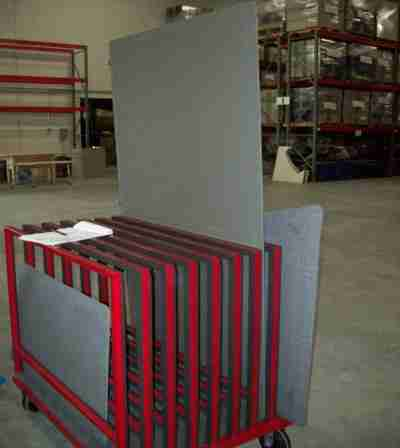 Floor screens were shipped flat on a plywood deck pallet in corrugated. They were transferred to a rack 25 miles away for final delivery, eliminating trash and superior material handling at the installation site.