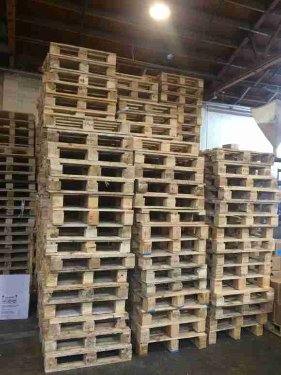 This accumulation of small sized pallets from a foreign supplier was problematic for one U.S. manufacturer to remove from its facility.