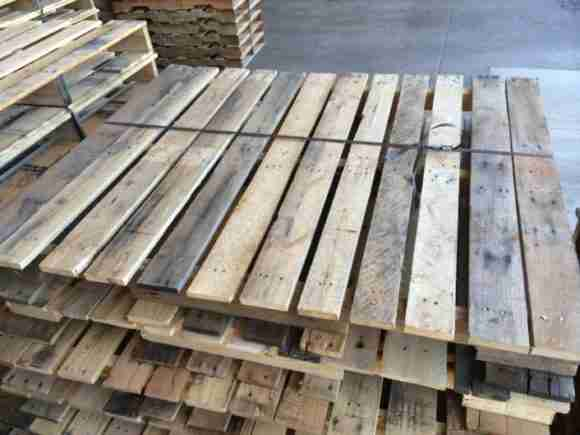 Remanufactured pallets I delivered to a customer. Lumber is discolored but pallets are consistent and built to specification.