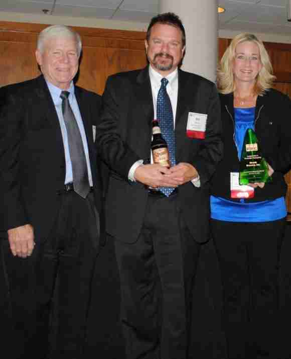 Pictured are PRC Executive Director Bob Jondreau with Straub Brewery's President & CEO Bill Brock and V.P. of Marketing, Sales, & PR Cathy Lenze at PRC's Environmental Leadership Awards celebration